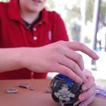 Megan Kane skillfully reconstructing a porcelain vessel!
